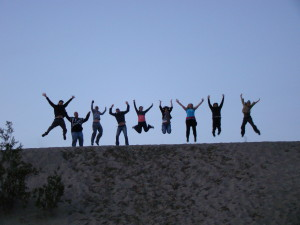 Why find your Trek America buddies? Because you'll be so excited you'll want to jump up and down with excitement like we are on a sand dune in Death Valley as dusk!
