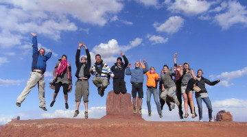 Trexpert image: Trek America tour group jumping in Monument Valley